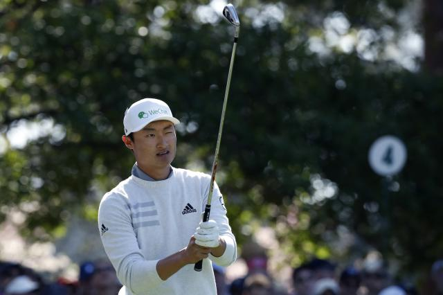 Li Haotong of China eyes the 4th hole before hitting during second round play of the 2018 Masters golf tournament at the Augusta National Golf Club in Augusta, Georgia, U.S., April 6, 2018. REUTERS/Mike Segar