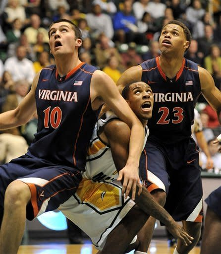 Virginia's Mike Tobey (10) and Justin Anderson (23) try to pin down George Mason's Anali Okoloji as they eye ahe shot at the basket during an NCAA college basketball game, Friday, Nov. 9, 2012, in Fairfax, Va. George Mason defeated Virginia 63-59. (AP Photo/Richard Lipski)