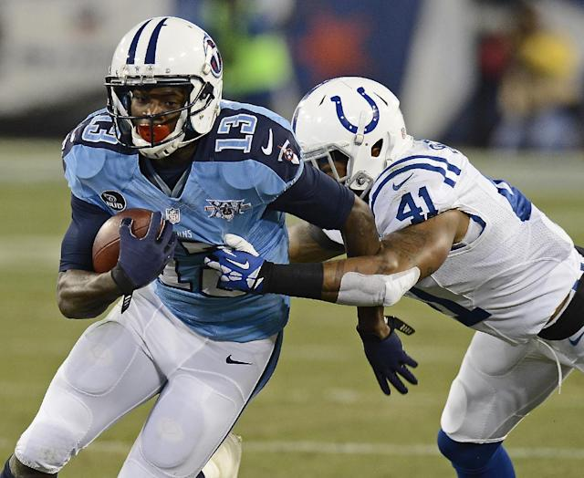 Tennessee Titans wide receiver Kendall Wright (13) is stopped by Indianapolis Colts safety Antoine Bethea (41) in the first quarter of an NFL football game Thursday, Nov. 14, 2013, in Nashville, Tenn. (AP Photo/Mark Zaleski)