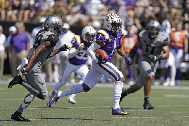LSU wide receiver Ja'Marr Chase (1) scores a touchdown on a 51-yard pass play for a touchdown against Vanderbilt in the first half of an NCAA college football game Saturday, Sept. 21, 2019, in Nashville, Tenn. (AP Photo/Mark Humphrey)