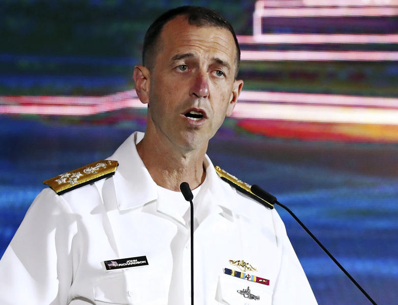 FILE - In this May 5, 2019 file photo, U.S. Chief of Naval Operations Adm. John Richardson delivers a speech during the International Maritime Security Conference on the sidelines of the International Maritime Defense Exhibition in Singapore. Richardson is scheduled to visit the U.S. Naval War College in Newport, R.I., on Wednesday, June 12, 2019, just days after the president of the college was removed from his post. (AP Photo/Yong Teck Lim, File)
