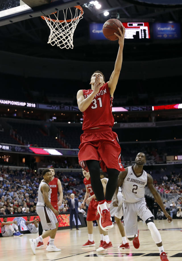 Davidson guard Kellan Grady (31) shoots in front of St. Bonaventure guard Matt Mobley (2) during the first half of an NCAA college basketball game in the semifinals of the Atlantic 10 Conference tournament, Saturday, March 10, 2018, in Washington. (AP Photo/Alex Brandon)