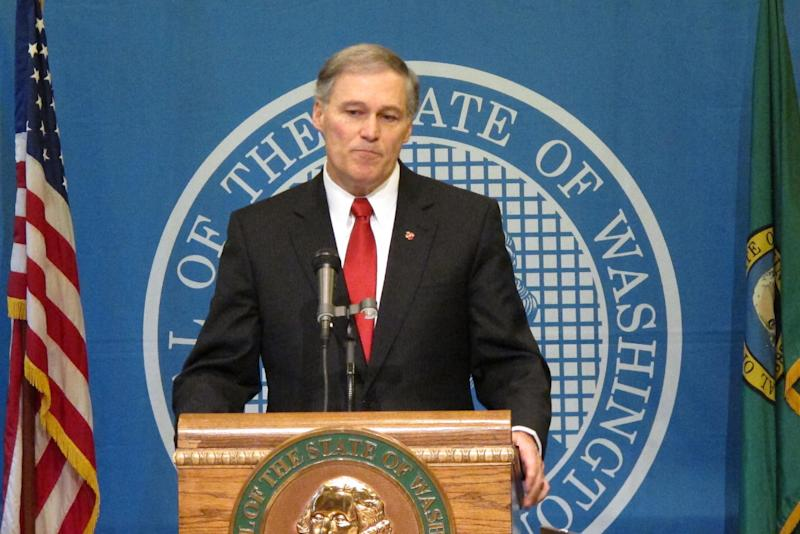 Wash. Gov. Jay Inslee announces Tuesday, Feb. 11, 2014, that he is suspending the use of the death penalty in Washington state. Inslee's moratorium, which will be in place for as long as he is governor, means that if a death penalty case comes to his desk, he will issue a reprieve, which isn't a pardon and doesn't commute the sentences of those condemned to death. (AP Photo/Rachel La Corte)