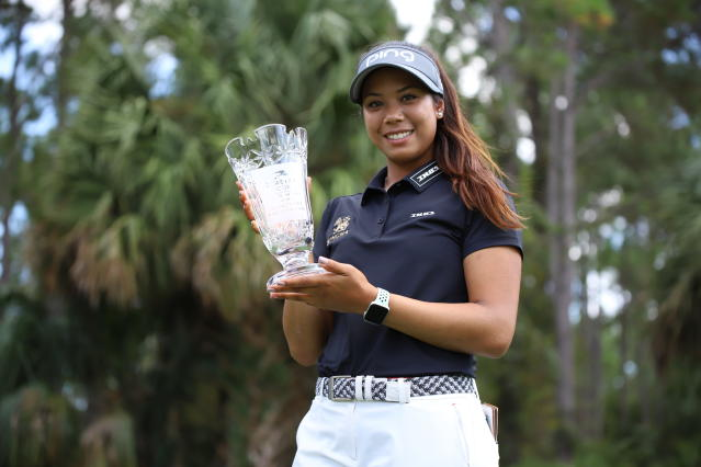 In this photo provided by the LPGA/Symetra Tour, Patty Tavatanakit poses with the trophy as Symetra Tour rookie of the year. The 20-year-old Thai from UCLA needed only three months to earn an LPGA Tour card for 2020. (Zachary Sepanik/LPGA/Symetra Tour via AP)