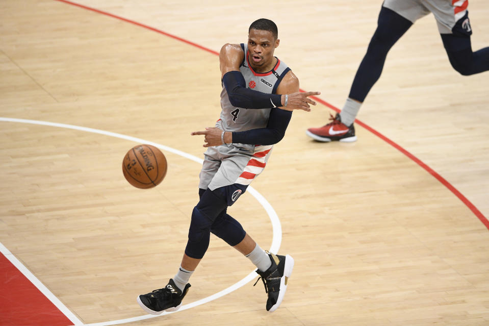 Washington Wizards guard Russell Westbrook passes the ball during the first half of the team's NBA basketball Eastern Conference play-in game against the Indiana Pacers, Thursday, May 20, 2021, in Washington. (AP Photo/Nick Wass)