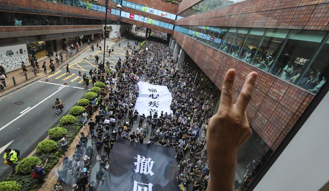 Demonstrators march in Sha Tin to demand the withdrawal of the extradition bill last Sunday. Photo: Felix Wong