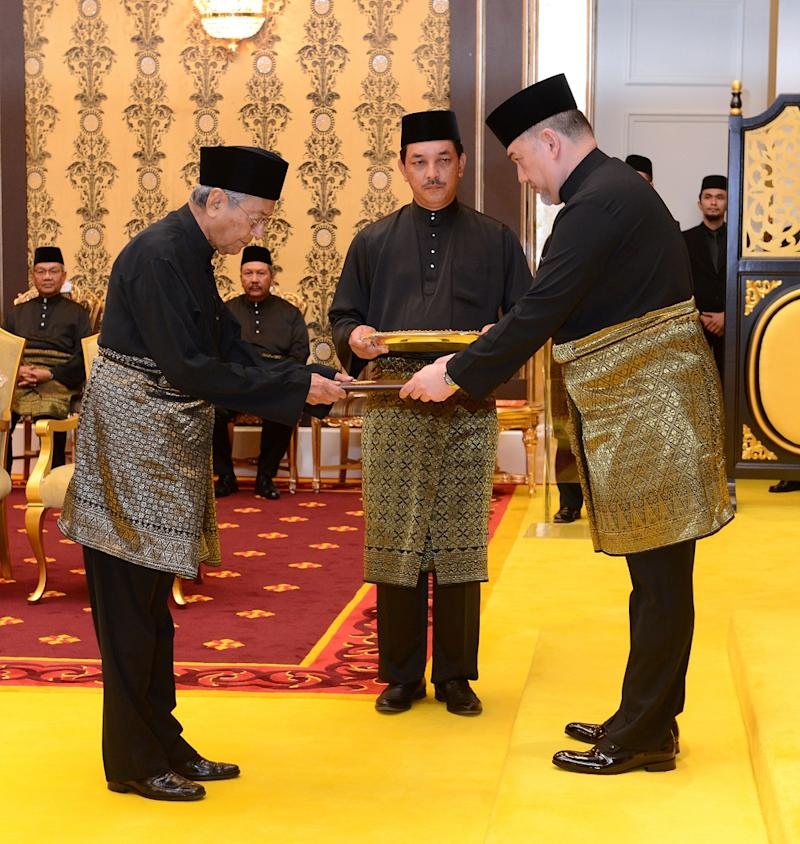 Dr Mahathir being sworn in as Malaysia's seventh prime minister at the National Palace. The 92-year-old premier was also the country's fourth prime minister, a role he assumed in 1981. — Picture by AFP