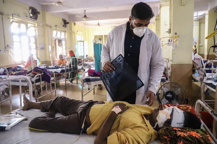 A doctor assists a Covid-19 coronavirus patient with Black Fungus, a deadly and rare fungal infection (AFP via Getty Images)