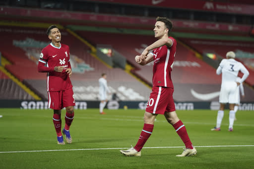 Liverpool's Diogo Jota, center, celebrates after scoring his sides second goal during the English Premier League soccer match between Liverpool and Leicester City at Anfield stadium in Liverpool, England, Sunday, Nov. 22, 2020. (AP Photo/Jon Super)