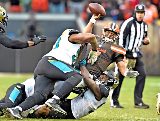 <p>Cleveland Browns quarterback DeShone Kizer (7) is sacked in the second half of an NFL football game against the Jacksonville Jaguars, Sunday, Nov. 19, 2017, in Cleveland. (AP Photo/David Richard) </p>