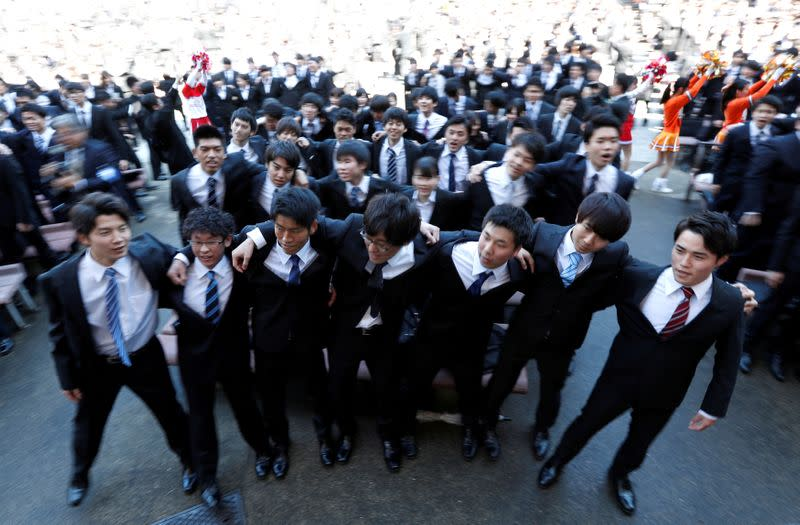FILE PHOTO: Japanese college students scrum during a pep rally held to boost their morale ahead of their job hunt in Tokyo