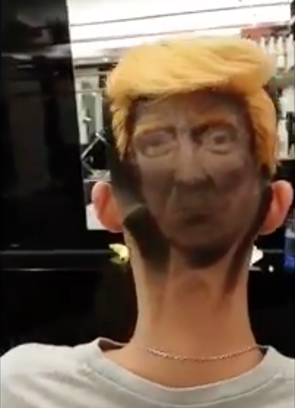 The man now has Donald Trump's face etched in the back of his head. (Photo: Storyful)