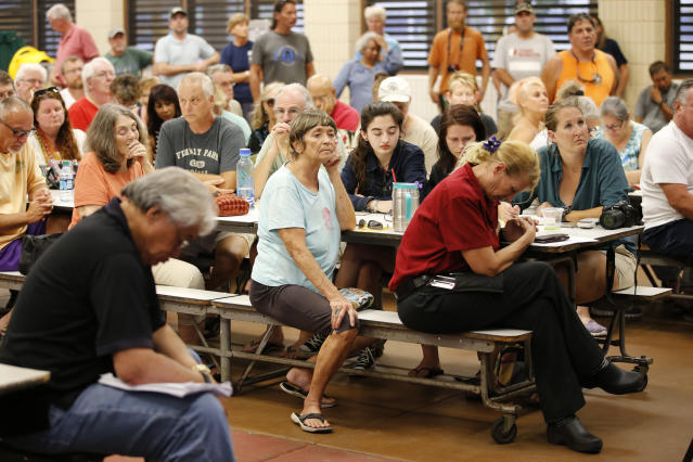 <p>Residents from the lava affected areas of the Big Island hold a prayer before the start of a community meeting with local authorities at Pahoa High School, Friday, May 4, 2018, in Pahoa, Hawaii. (Photo: Marco Garcia/AP) </p>