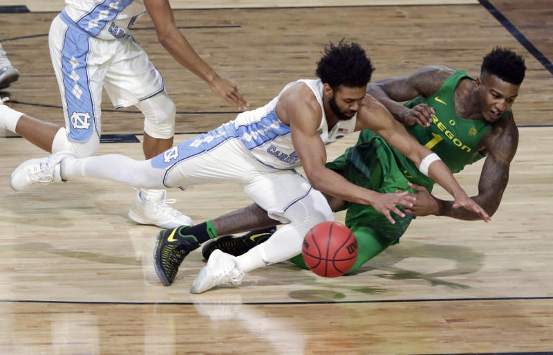 Oregon's Jordan Bell (1) chases a loose ball against North Carolina's Joel Berry II during the second half in the semifinals of the Final Four NCAA college basketball tournament, Saturday, April 1, 2017, in Glendale, Ariz. (AP Photo/Matt York)