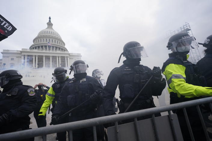 FILE - In this Jan. 6, 2021, file photo, police stand guard after holding off violent rioters who tried to break through a police barrier at the Capitol in Washington. New details from the deadly riot of Jan. 6 are contained in a previously undisclosed document prepared by the Pentagon for internal use that was obtained by the Associated Press and vetted by current and former government officials. (AP Photo/Julio Cortez, File)
