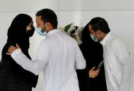 People welcome their relatives who arrived from Doha, at King Khalid International Airport in Riyadh
