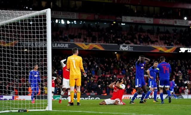 Aubameyang (centre) was left floored by a late miss which would have seen Arsenal through (John Walton/PA)