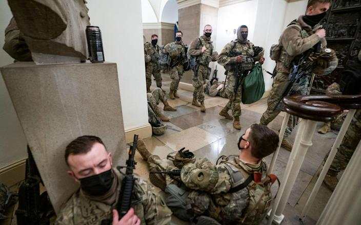 Members of the National Guard try to get some sleep inside the US Capitol - JIM LO SCALZO/EPA-EFE/Shutterstock /Shutterstock