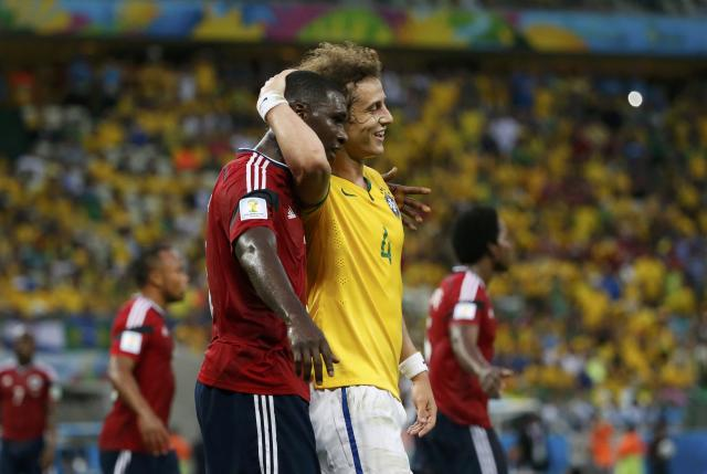 Colombia's Cristian Zapata (L) embraces Brazil's David Luiz during their 2014 World Cup quarter-finals at the Castelao arena in Fortaleza July 4, 2014. REUTERS/Jorge Silva (BRAZIL - Tags: SOCCER SPORT WORLD CUP)