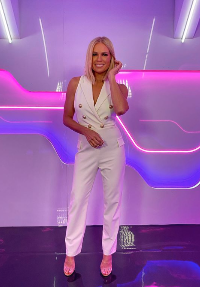Sonia Kruger in a white jumpsuit on Big Brother Australia