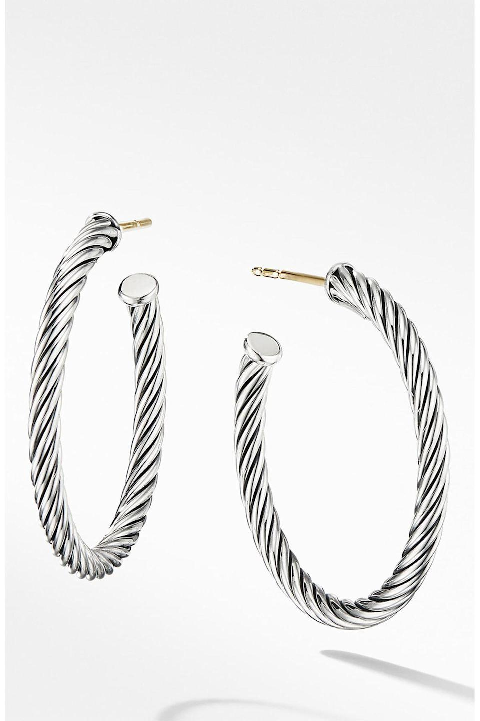 """<p><strong>David Yurman</strong></p><p>nordstrom.com</p><p><strong>$325.00</strong></p><p><a href=""""https://go.redirectingat.com?id=74968X1596630&url=https%3A%2F%2Fshop.nordstrom.com%2Fs%2Fdavid-yurman-cable-loop-hoop-earrings%2F5138612&sref=https%3A%2F%2Fwww.townandcountrymag.com%2Fstyle%2Fjewelry-and-watches%2Fg33469392%2Fthe-weekly-covet-july-31-2020%2F"""" rel=""""nofollow noopener"""" target=""""_blank"""" data-ylk=""""slk:Shop Now"""" class=""""link rapid-noclick-resp"""">Shop Now</a></p><p>Classic with a twist -- literally. Upgrade your favorite silver hoops for a pair with some texture.</p>"""