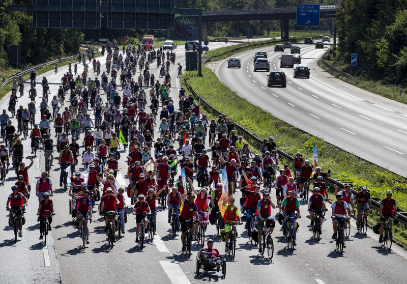 Demonstrators ride their bikes on a highway in Frankfurt, Germany, Saturday, Sept. 14, 2019. About 20,000 cyclists took part in a protest star ride against the government's transport policy on occasion of this year's IAA Auto Show.(AP Photo/Michael Probst)
