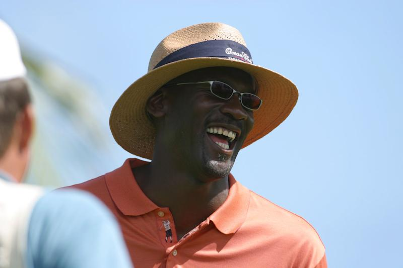 Michael Jordan enjoys a laugh during his Celebrity Invitational at the Ocean Club Golf Course on Sunday, Sept. 22, 2002 at the Ocean Club resort on Paradise Island in the Bahamas. The tournament hopes to raise $500,000 matching the amount reached at the inaugural event last year, with the funds going to the Ronald McDonald Houses of North Carolina and a local Bahamian charity. (AP Photo/Tim Aylen)