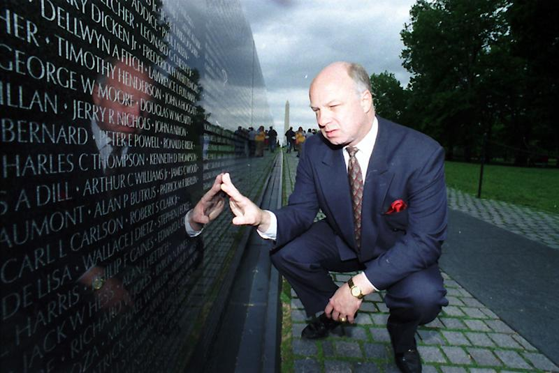 FILE - In this May 17, 1994 file photo, John Wheeler III touches the name of a friend engraved in the Vietnam Veterans Memorial in Washington. Wheeler's body was discovered Dec. 31, 2010 as a waste management truck emptied its contents at the Wilmington, Del.-area landfill. His death has been ruled a homicide. (AP Photo/Charles Tasnadi, File)