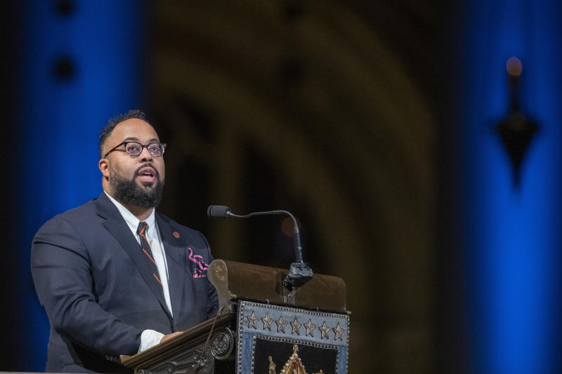 Poet Kevin Young speaks during the Celebration of the Life of Toni Morrison, Thursday, Nov. 21, 2019, at the Cathedral of St. John the Divine in New York. Morrison, a Nobel laureate, died in August at 88. (AP Photo/Mary Altaffer)