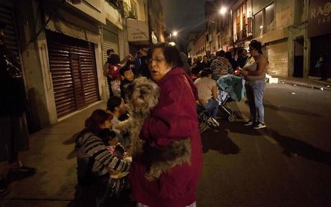 <span>People gather on a street in downtown Mexico City during an earthquake</span> <span>Credit: AFP </span>