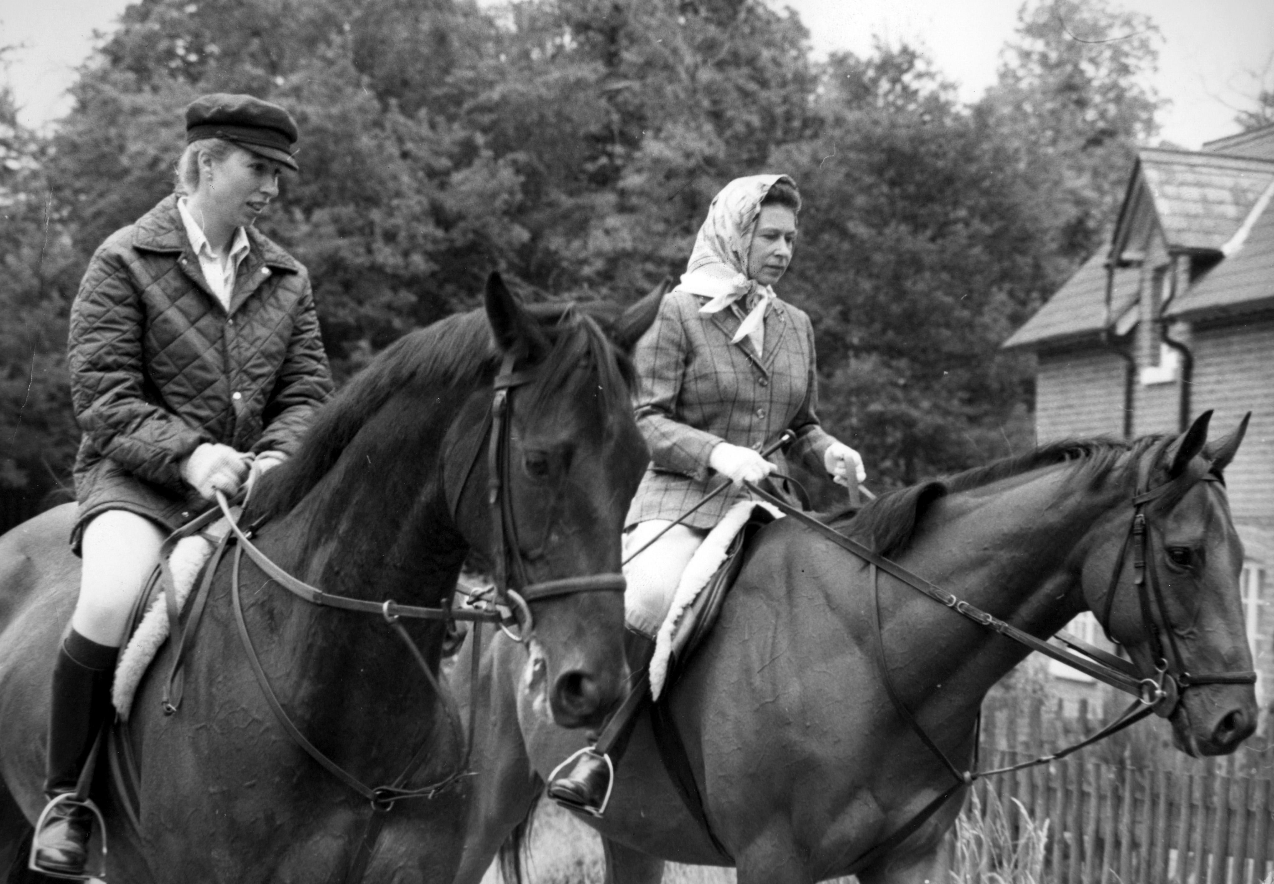 The Queen and Princess Anne riding at Ascot, where they were later among the Royal spectators on Gold Cup day. (Photo by PA Images via Getty Images)