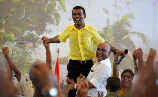 Former Maldives president Mohamed Nasheed greets supporters in Male in February 2012