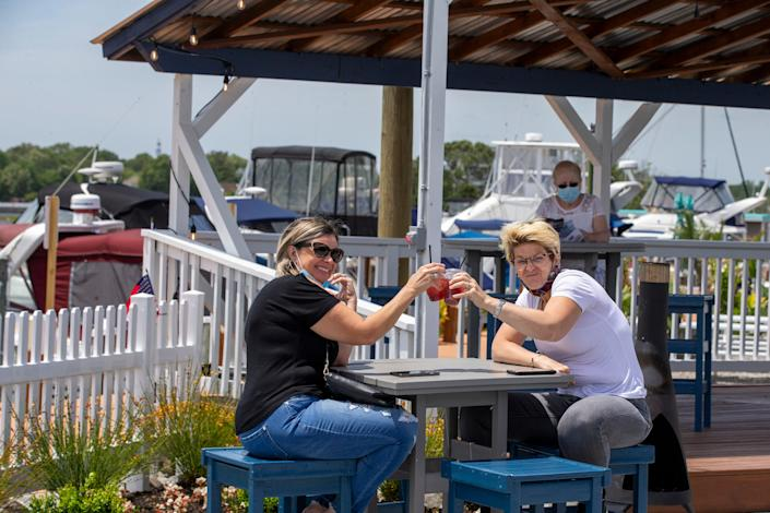 Laurie Krevalo, of Lacey Township, and Christa Fabro, of Lanoka Harbor, enjoy the first day of outdoor dining at The Waterfront in Lacey Township, N.J., on Monday.