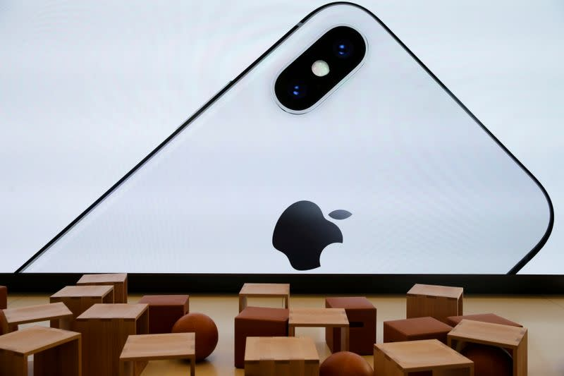 FILE PHOTO: An iPhone X is seen on a large video screen in the new Apple Visitor Center in Cupertino