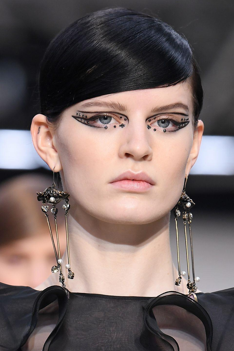 <p>The graphic black eyeliner and dark crystals at Valentino gave us an elevated version of mall goth.</p>