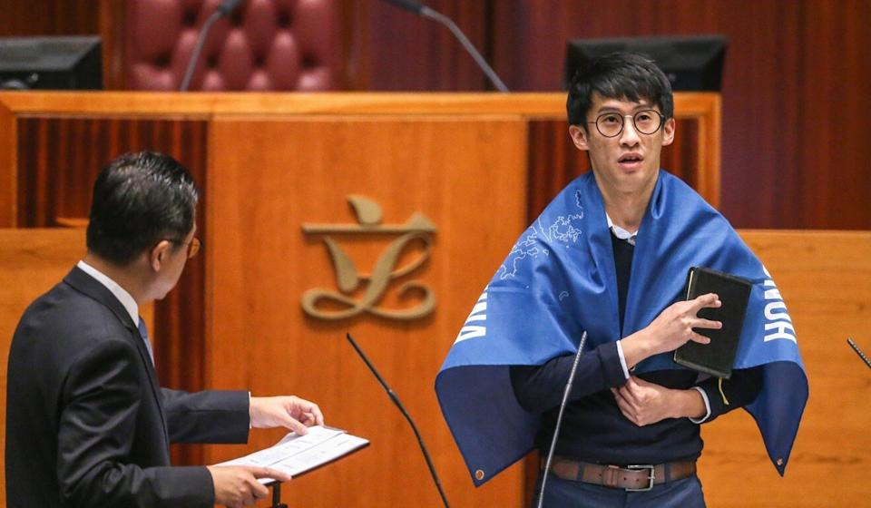 Lawmaker-elect Baggio Leung wraps himself in banner stating Hong Kong is not part of China during his oath-taking session in the Legislative Council in October 2016. Photo: Sam Tsang
