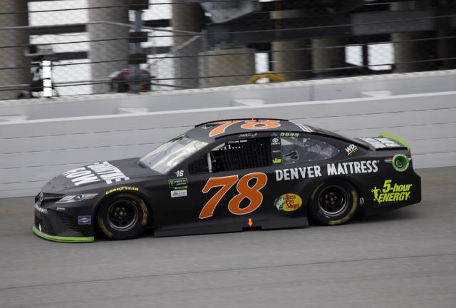 "<a class=""link rapid-noclick-resp"" href=""/nascar/sprint/drivers/380/"" data-ylk=""slk:Martin Truex Jr."">Martin Truex Jr.</a>, drives during the NASCAR Cup auto race at Chicagoland Speedway in Joliet, Ill., Sunday, Sept. 17, 2017. (AP Photo/Nam Y. Huh)"