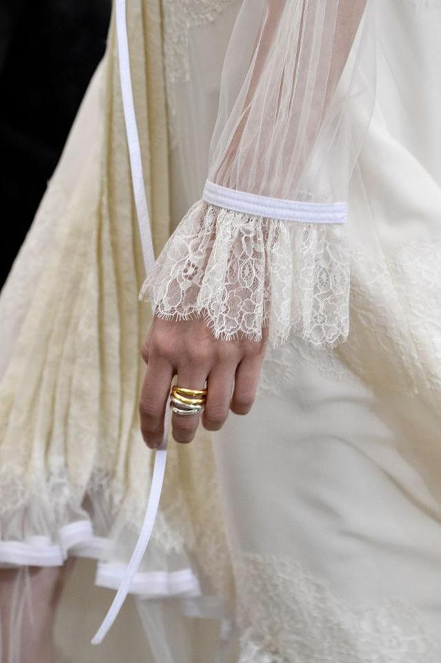 <p>Gold and silver stacked rings at the Tory Burch FW18 show. (Photo: Getty Images) </p>
