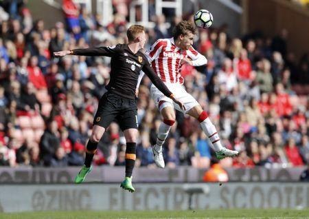 Britain Soccer Football - Stoke City v Hull City - Premier League - bet365 Stadium - 15/4/17 Stoke City's Marc Muniesa in action with Hull City's Sam Clucas Action Images via Reuters / Carl Recine Livepic