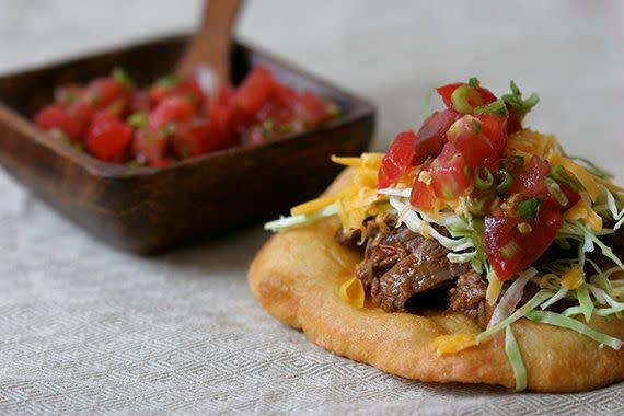 "<strong>Get the <a href=""http://food52.com/recipes/6161-fry-bread-tacos"" rel=""nofollow noopener"" target=""_blank"" data-ylk=""slk:fry bread tacos recipe"" class=""link rapid-noclick-resp"">fry bread tacos recipe</a> by Globetrotter via Food52.</strong>"