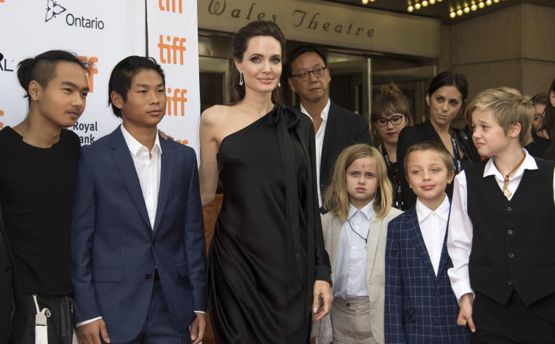 Jolie poses with some of her children at the Toronto International Film Festival. (VALERIE MACON via Getty Images)