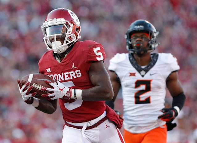 Oklahoma wide receiver Marquise Brown runs in for a touchdown. (AP)
