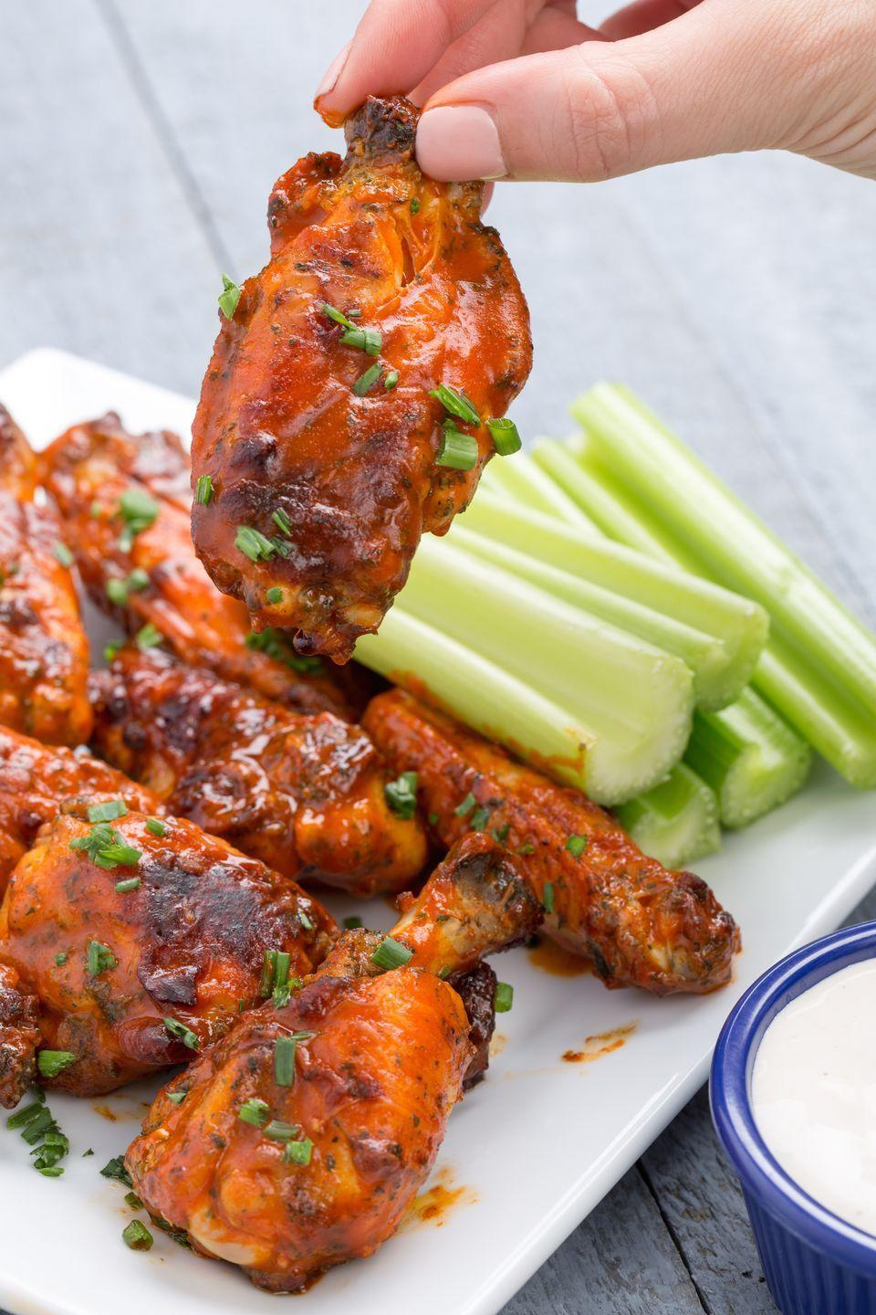 """<p>Any true football fan knows that Game Day isn't complete without buffalo ranch <em>something</em>. These are doused in ranch seasoning and sprinkled with fresh chives for extra flavor.</p><p>Get the recipe from <a href=""""https://www.delish.com/cooking/recipe-ideas/recipes/a44367/slow-cooker-buffalo-ranch-wings-recipe/"""" rel=""""nofollow noopener"""" target=""""_blank"""" data-ylk=""""slk:Delish"""" class=""""link rapid-noclick-resp"""">Delish</a>. </p>"""