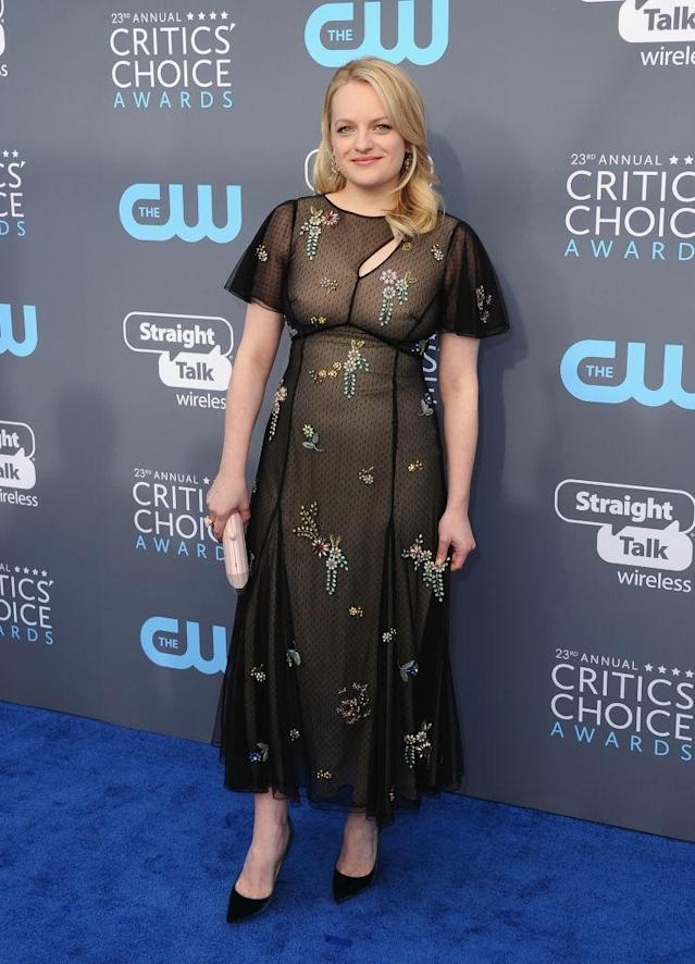 <p>Moss stuck with black but added some flowers with her Erdem dress for the occasion. (Photo: Getty Images) </p>