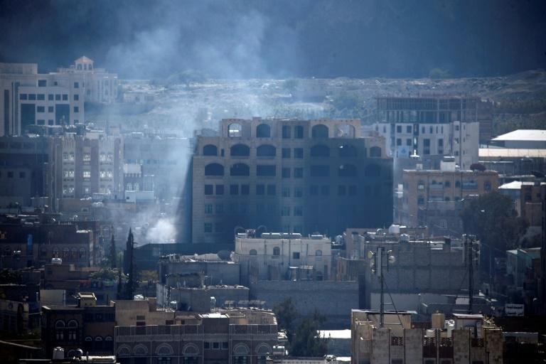 Smoke billows over the rebel-held Yemeni capital Sanaa during clashes between Huthi rebels and supporters of now slain ex-president Ali Abdullah Saleh