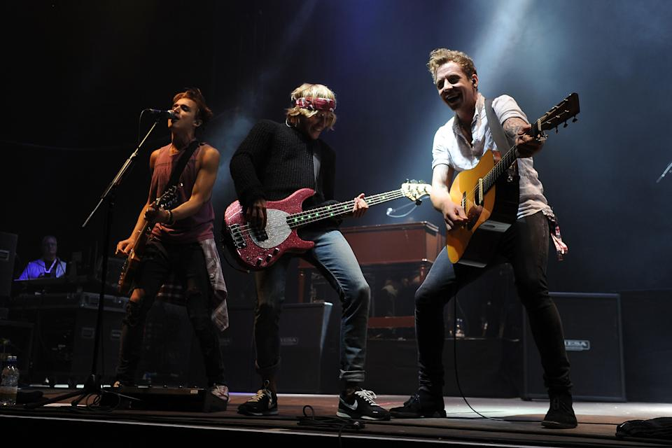 McFly performs on the Virgin Media stage during day one of the V Festival at Weston Park in Weston-under-Lizard.