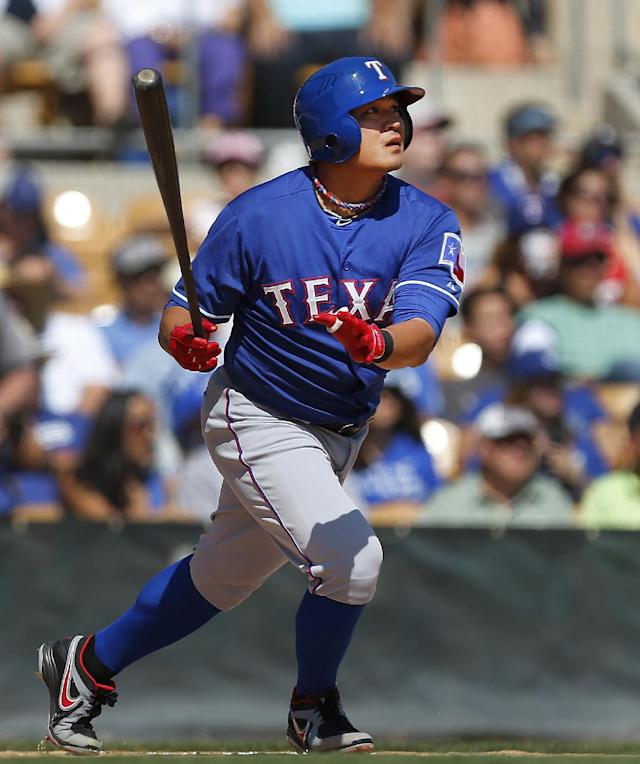 Texas Rangers' Shin-Soo Choo doubles against the Los Angeles Dodgers during an exhibition baseball game in Glendale, Ariz., Friday, March 7, 2014. (AP Photo/Paul Sancya)