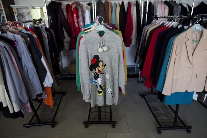 In this Dec. 9, 2011 photo, a Minnie Mouse sweater and other clothing items are displayed for sale at a shop in Pyongyang, North Korea. A new culture of commerce is springing up, with China as its inspiration and source. The new consumerism is part of a campaign launched three years ago to build up the economy, and so the image of new leader Kim Jong Un. (AP Photo/David Guttenfelder)