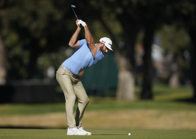 Dustin Johnson hits his second shot on the 11th hole during the second round of the Genesis Invitational golf tournament at Riviera Country Club, Friday, Feb. 14, 2020, in the Pacific Palisades area of Los Angeles. (AP Photo/Ryan Kang)