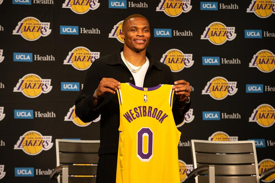 Russell Westbrook poses with 0 jersey during the Los Angeles Lakers